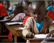School child focused on his work.